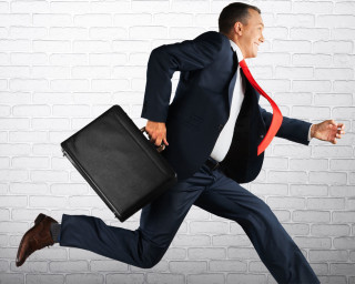 man-running-with-briefcase