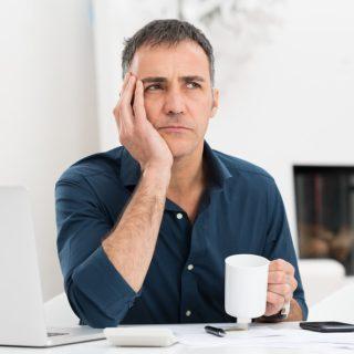 worried-man-at-desk
